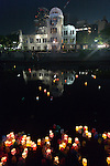 Candle lanterns drift downstream on August 6, 2015, in Hiroshima, Japan, in front of the city's atomic bomb dome. The floating lanterns, thousands of which were launched on the 70th anniversary of the atomic bombing of the city, carry handmade messages and drawings, conveying each person's prayers for peace and comfort for the victims of the violence.