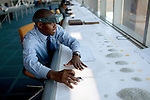 GABORONE, BOTSWANA - SEPTEMBER 21: A man sorts raw diamonds as they are displayed on long tables at the new Diamond Trading Company (DTC), the world's largest and most advanced diamond-sorting and valuing facility on September 21, 2009 in Gaborone, Botswana. It's a 50:50 joint venture between De Beers and the government or Botswana. This is a venture to bring back employment opportunities to Africa, the source of most diamonds in the world. Many of De Beers biggest customers are setting up diamond cutting, polishing, marketing for rough diamonds and it will lead to many new jobs created. (Photo by Per-Anders Pettersson)...