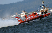 Hydros-PROP Seafair, Lake Washington, Seattle, Washington, USA 4 August,2002 .Drive Dave Villwock flies the Miss Budweiser Unlimited Hydroplane across the finish line to win the Texaco Cup at Seattle's Seafair..Copyright©F.Peirce Williams 2002..F. Peirce Williams.photography.P.O. Box 455 Eaton, OH 45320 USA.317.358.7326  fpwp@mac.com .
