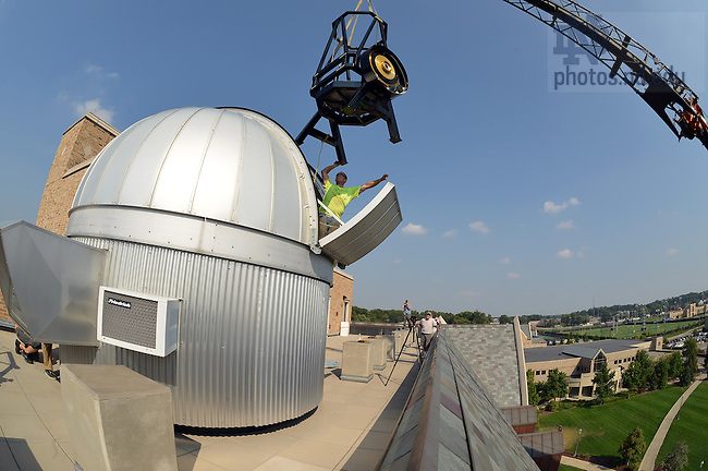 Sept. 9, 2013; The framework for the Jordan Hall of Science observatory telescope is craned into place.<br /> <br /> Photo by Matt Cashore/University of Notre Dame