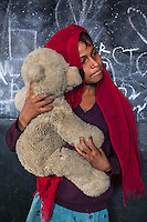 Bushra, 6, poses for a portrait with a soft toy in the Guria Non-Formal Education center in the middle of the Shivdaspur red light district, Varanasi, Uttar Pradesh, India on 20 November 2013. Guria uses the soft toys as a form of therapy for the children of the women in prostitution and also use it as signals of the children's emotional wellbeing.
