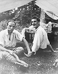 North East PA: Brady and Clark Stewart posing for a photo outside their tent during a camping trip to Lake Erie.  Brady and Clark were the best of friends along with being brothers. During the early 1900s, the Stewart family vacationed on Lake Erie near North East Pennsylvania. Since hotels and motels were non-existent, camping was the only viable option for a large number of vacationers