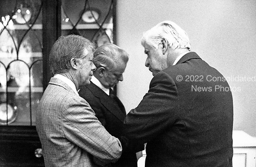 United States President Jimmy Carter talks with the Speaker of the US House of Representatives Thomas P. &quot;Tip&quot; O'Neill (Democrat of Massachusetts) and US Senate Majority Leader Robert Byrd (Democrat of West Virginia) following the Democratic Congressional Leadership Breakfast in the first floor Private Dining Room of the White House in Washington, DC on January 25, 1977.<br /> Credit: White House via CNP