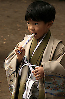 Japanese boy at Shichi-Go-San, literally seven-five-three, a traditional rite of passage in Japan held annually on November 15.  Shichi-Go-San is not a national holiday, so it is often observed on the nearest weekend.  Boys who are aged three or five and girls who are aged three or seven are dressed in kimono, many for the first time, for visits to shrines.