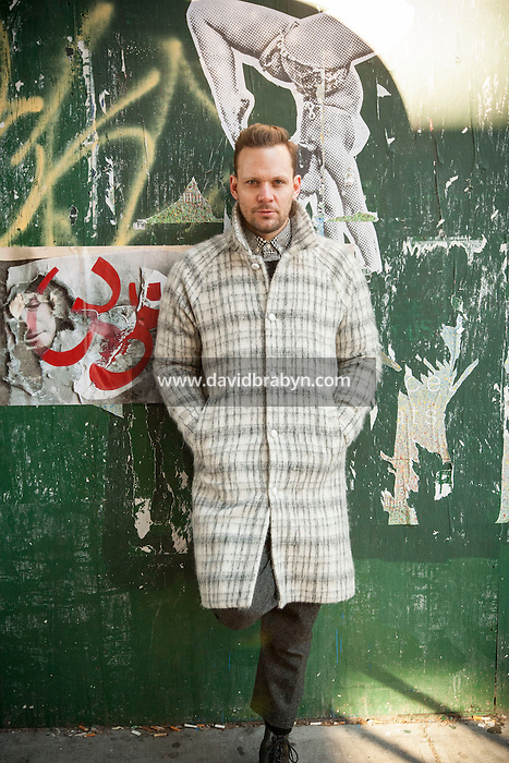 HSHU 20150117 United States, New York. Finnish designer Teemu Suviala, Creative Director at global branding agency Wolff Olins poses for the photographer. Photographer: David Brabyn.