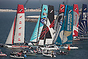 Extreme Sailing Series 2011. Leg 1. Muscat. Oman.Day 5 of racing.   Picture showing the fleet at the start line.