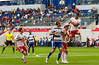 Tim Cahill (17) of the New York Red Bulls goes up for a header during a Major League Soccer (MLS) match at Red Bull Arena in Harrison, NJ, on September 22, 2013.