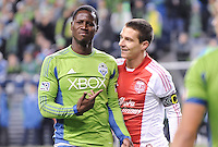 November, 2013: CenturyLink Field, Seattle, Washington: Seattle Sounders FC forward Eddie Johnson (7) points at Portland Timbers midfielder Will Johnson (4)  as the Portland Timbers defeat  the Seattle Sounders FC 2-1 in the Major League Soccer Playoffs semifinals Round.