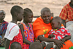 In Rumbek, South Sudan, a grandmother speaks to the children about preventing malaria by sleeping under long lasting insecticide-treated mosquito nets.