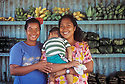 Chuuk, Micronesia: women &amp; baby in roadside produce stand on Weno Island (Marinta Hater, Cathy Andeneas, Even Boy).  .#3323-1414