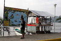 Tourist pondering a map of Laguna Catemaco a large volcanic lake in the state of Veracruz, Mexico