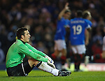 Aberdeen goalkeeper Jamie Langfield is disconsolate as Rangers celebrate scoring goal no 2