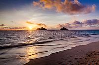 Lanikai Beach at sunrise, Kailua, O'ahu, with the Mokuluas in the distance.