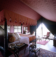 Each bedroom tent has a four-poster bed with a striped canopy