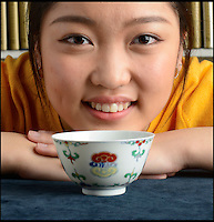 BNPS.co.uk (01202 558833)Pic: Woolley&amp;Wallis/BNPS<br /> Jasmine Lin from Woolley &amp; Wallis took the Chinese telephone bid.<br /> <br /> Bidding frenzy over a wine cup.<br /> <br /> A tiny 10cm wine cup has astonished auctioneers by selling for nearly &pound;500,000.<br /> <br /> The chinese porcelain Lingzhi or wine bowl dating from the early 18th century sold for &pound;482,800 at Woolley &amp; Wallis auctioneers in Salisbury on friday.