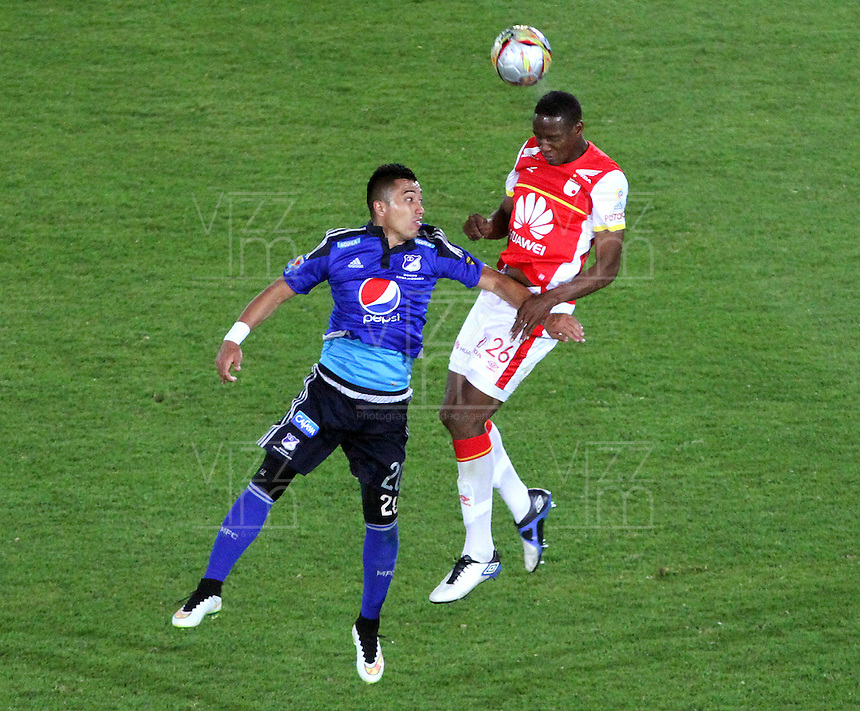 BOGOTA -COLOMBIA, 14-MARZO-2015. Fernando Uribe de Millonarios  disputa el balon contraYerry Mina  del Independiente Santa Fe  durante la decima fecha de La Liga Aguila jugado en el estadio Nemesio Camacho El Campin  of  Bogota . /  Fernando Uribe of  Millonarios   dispute for the ball against  Yerry Mina  of Independiente Santa Fe  during the tenth round of La Liga Aguila played at the Nemesio Camacho El Campin stadium in Bogota . Photo / VizzorImage / Felipe Caicedo  / Staff