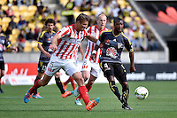 Rolieny Bonevacia and Erik Paartalu in action during the A League - Wellington Phoenix v Melbourne City at Westpac Stadium, Wellington, New Zealand on Sunday 30 November 2014.