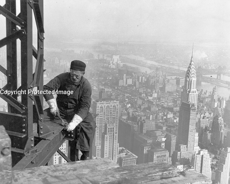 By Lewis Hine, 1930.<br /> Old-timer, -- keeping up with the boys. Many structural workers are above middle-age. Empire State [Building].<br /> New York City, New York.<br /> 1998 print.