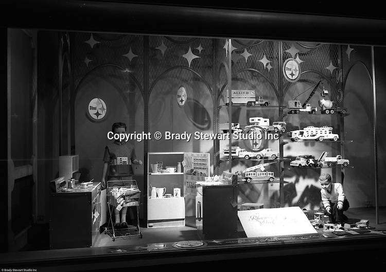 Pittsburgh PA: View of Christmas window display at Horne's department store in downtown Pittsburgh. Steel toys on display during the Rhapsody of Steel campaign. US Steel launched an awareness campaign of all the current uses of steel in everyday products.  During this time, ALCOA Aluminum Company of America also headquartered in Pittsburgh, was aggressively competing to enter markets where US  steel companies traditional dominated market share. Examples included beer and food Cans, appliances, automobile parts, children toys / bicycles, and more.