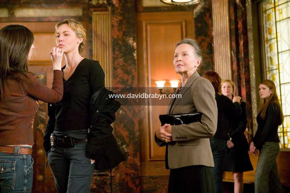 """8 May 2006 - North Bergen, NJ - Actresses Leslie Caron (3L) prepares for a scene as Connie Nielsen (2L) and Diane Neal (2R) get hair and makeup retouches while lily Rabe (R) waits on the studio set of television show """"Law & Order: SVU"""" in North Bergen, USA, 8 May 2006. In this rare appearance in front of American television cameras, Caron, 74, plays a French victim of past sexual molestation in an episode entitled """"Recall"""" due to air in the fall. Caron starred in Hollywood classics such as """"An American in Paris"""" (1951), """"Lili"""" (1953), """"Gigi"""" (1958). More recently she appeared in """"Chocolat"""" (2000) and """"Le Divorce"""" (2003). Photo Credit: David Brabyn"""