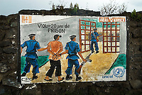 A wall painting on the side of the road leading out of the Kibati IDP (Internally Displaced Persons) camp states that rape is punishable by 20 years in prison.
