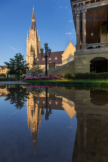 Aug. 11, 2015; Basilica steeple reflected in a puddle. (Photo by Matt Cashore/University of Notre Dame)