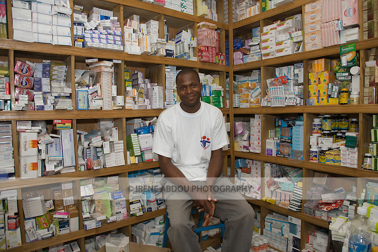 A Society for Family Health (SFH) detailer sits inside a pharmacy in Abuja, Nigeria.  SFH is Nigeria's largest indigenous non-governmental organization (NGO) and partner of the international social marketing organization, Population Services International (PSI).