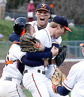 March 29, 2011 - Charlottesville, VA. USA; From left, Virginia's Kenny Swab and Steven Proscia mob pitcher Will Roberts after completing the first perfect game in school history against George Washington Tuesday night at Davenport Stadium. It's the 8th 9-inning perfect game in NCAA Division 1 play since 1957. Photo/Andrew Shurtleff
