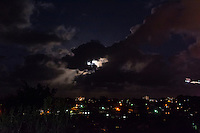 Tugun, Queensland Australia. (Wednesday March 19, 2014) –  The moon rising over Tugun and Coolangatta on the night of the 19th of March, the Equinox, with a plane crossing the moon on it's descent into Coolangatta airport.  Photo: joliphotos.com
