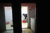 BIARA, IRAQ: Yahia Salah (15) cleans the hamam--traditional bathroom...The Biara Madrassa--a religious school--is located high up in the mountainous Kurdish Hawraman region that makes up the Iran/Iraq border. Before 2003 the region was home to a fundamentalist Islamic group called Ansar al-Islam who used the school as a base. The Unites States military attacked the area and the madrassa numerous times during the 2003 invasion, finally pushing Ansar al-Islam out...Today the madrassa is home to 48 male students from all across Kurdish Iraq. The students leave their families and immerse themselves in their studies and the daily life of Koranic students...Photo by Besaran Tofiq