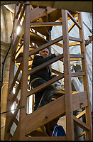 BNPS.co.uk (01202 558833)<br /> Pic: TomWren/BNPS<br /> <br /> Clerk of the Works, Gary Price ascends the stairs to the bell level.<br /> <br /> How many men does it take to change a lightbulb... at the top of Britain's tallest spire.<br /> <br /> When your office is Salisbury Cathedral the simple task of changing a light bulb involves four men, a 404ft climb and takes three hours.<br /> <br /> Ecclesiastical carpenter Richard Pike needed a head for heights when he joined Gary Price, who is in charge of conservation, to make the daring ascent with two rope specialists to ensure their safety. <br /> <br /> Despite working at the cathedral for 27 years, it was the first time Richard has ever made the hair-raising climb.