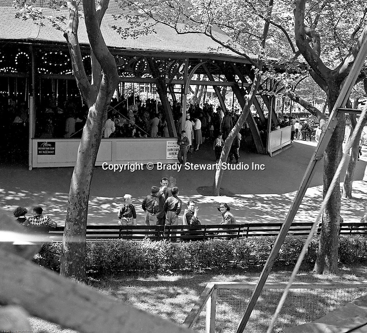 West Mifflin PA:  View of the Merry-Go-Round at Kennywood Park - 1956.  The Stewart and Panneton families visited Kennywood during the fall of 1956 - families in foreground.  Kennywood Park is one of the oldest amusement parks in America, founded in 1898. Kennywood Park was a big part of our childhood in the Pittsburgh area. At the end of each school year, most school districts had a Kennywood Park Day.  The rides included the roller coasters; Jackrabbit, Racer and Thunderbolt along the infamous Old Mill where you could steal a kiss or two.  Kennywood was designated a National Historic Landmark since 1987