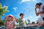 Riley and Tyler McPherson blow away at the Bubble Maker booth during the 33rd Annual Los Altos Arts &amp; Wine Festival.<br />