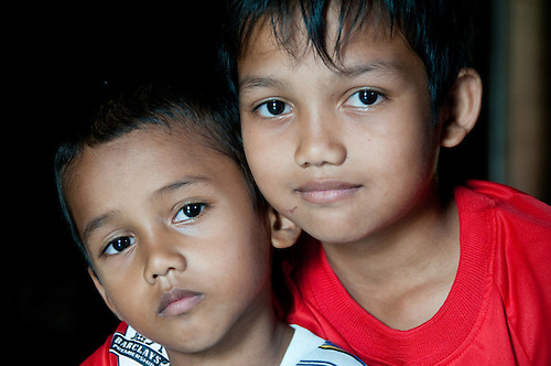 Indonesia, Sumatra, Aceh.  Brothers in Banda Aceh whose family survived the tsunami.