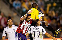 Goalkeeper Sean Johnson of the Chicago Fire goes high for a save over Chivas USA forward Giancarlo Maldonado (r) and teammate Bratislav Ristic (77). The Chicago Fire defeated CD Chivas USA 3-1 at Home Depot Center stadium in Carson, California on Saturday October 23, 2010.