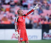 Jon Busch (18) of the San Jose Earthquakes yells to his team during a Major League Soccer game at RFK Stadium in Washington, DC.  D.C. United defeated San Jose Earthquakes, 1-0.