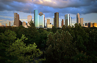 Stock photo of purple and magenta clouds over the downtown Houston skyline.