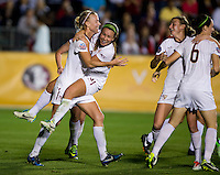 Nickolette Driesse (3) of Florida State celebrates her goal with teammate Dagny Brynjarsdottir (7) during the Women's College Cup semifinals at WakeMed Soccer Park in Cary, NC. Florida State defeated Virginia Tech, 3-2.
