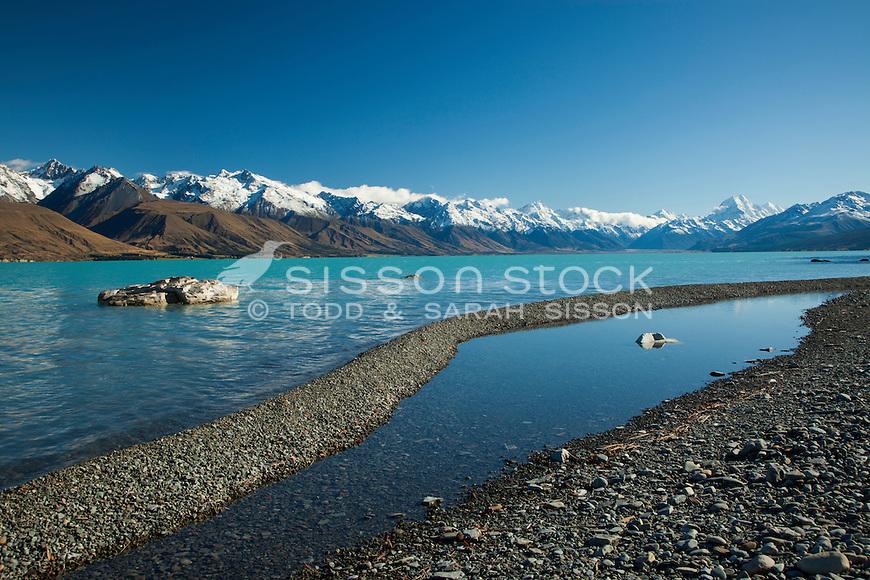 Aoraki Mt Cook and pond on the shore of Lake Pukaki. Mackenzie Country, South Canterbury South Island New Zealand.