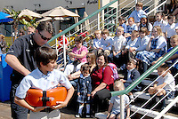 Santa Monica Harbor Patrol Officer David Finley demonstrates rescue techniques to elementary students from Beacon Hill Classical Academy (Camarillo) at the santa Monica Pier on Friday, April 15, 2011.