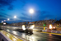 May 15, 2015; Commerce, GA, USA; NHRA top fuel driver Steve Torrence (left) races alongside Larry Dixon during qualifying for the Southern Nationals at Atlanta Dragway. Mandatory Credit: Mark J. Rebilas-USA TODAY Sports