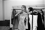 Paul and Linda McCartney Wings Tour 1975. Linda in her Wardrobe room trying, checking out a dress for her performance that night, Bristol, England..