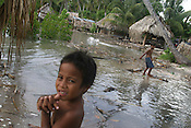 Children living next to the sea, on the South Pacific island of Kiribati,play in the water during a 'king tide' which flooded their land, and encroached on their homes, in the village of Buota.