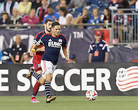 Foxborough, Massachusetts - September 7, 2014: In a Major League Soccer (MLS) match, the New England Revolution (blue/white) defeated Chicago Fire (red), 2-1, at Gillette Stadium.