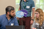 "Mark Riley, a Technical Support Analyst in the College of Health Sciences and Professions, left,  and Sean O'Malley, IT Communications Manager for the Office of Information Technology, center, and Lori Bauer, the Director of Communication for the College of Arts and Sciences, right, meet at the ""Conversation Area"" at the Campus Communicator Network Expo in Nelson Commons on Wednesday, May 11, 2016. Each booth had a table next to it known as the ""Conversation Area"" where people could sit and talk. © Ohio University / Photo by Kaitlin Owens"