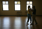 Paul and Cathy Wooster, from Estero, practice their dancing moves at Estero Community Park Tuesday morning. Inspired by Cathy's brother and his wife, she says who are beautiful dancers the Wooster's tired of sitting on the sidelines took up dancing two years ago. They started practicing at the community center out of necessity Cathy said their living room was a little cramped. When asked why they like dancing Paul responded &quot;Any excuse to hold my wife is a good one.  Erik Kellar/Staff