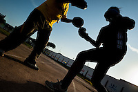 A Peruvian woman is seen during the sparring workout with her coach in the outdoor boxing school at the Telmo Carbajo stadium in Callao, Peru, 4 April 2013.