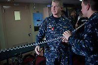 Captain James Ware, Commanding Officer of the USNS Comfort, a naval hospital ship, supervises the reception of patients being airlifted to the ship on Wednesday, January 20, 2010 in Port-Au-Prince, Haiti. The Comfort deployed from Baltimore, bringing nearly a thousand medical personnel to care for victims of Haiti's recent earthquake.