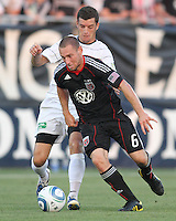 Kurt Morsink #6 of D.C. United takes the ball from Jason Hotchkin #11 of the Harrisburg City Islanders during a US Open Cup match at the Maryland Soccerplex on July 21 2010, in Boyds, Maryland. United won 2-0.