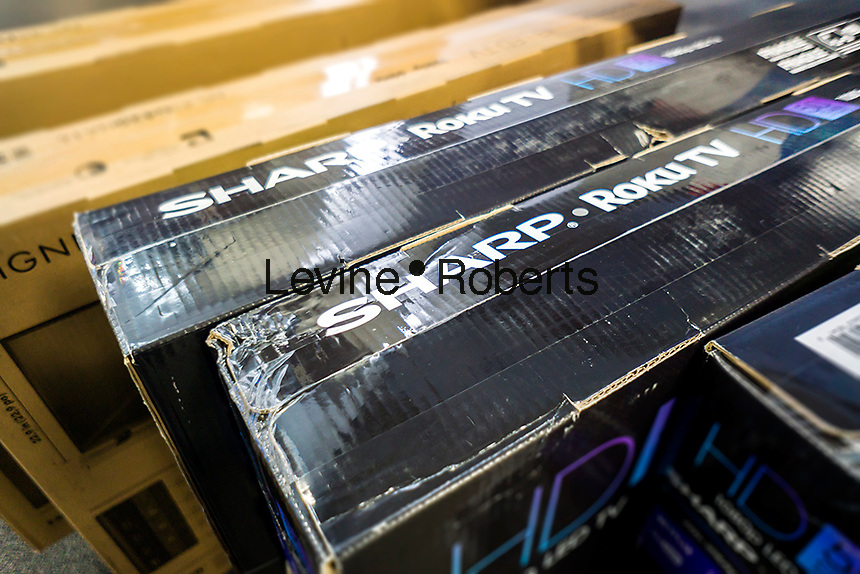 Boxes of Sharp brand televisions waiting to be sold in a Best Buy electronics store in New York on Wednesday, March 30, 2016. The Taiwanese electronics company Foxconn has agreed to buy Japanese electronics firm Sharp in a deal worth approximately $3.5 billion giving Foxconn two-thirds of Sharp. (© Richard B. Levine)